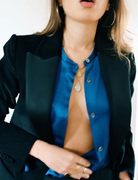 **Layered pendant necklaces**  If you want to take an outfit to the next level, add a second pendant necklace of your choosing and unbutton your shirt a little further to create that effortless sex appeal all French girls seem to possess.   (Photo: Instagram/Sarah Nait)