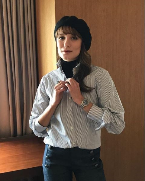 **A menswear-style watch**  Stolen from the boyfriend you do or don't have (who cares?) a chunky watch, preferably in silver, is practical and chic.   (Photo: Instagram/Ana Girardot)