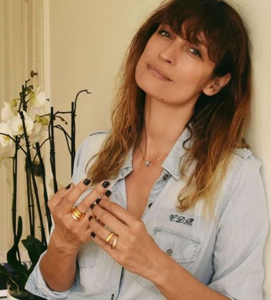 **Thick gold rings, stacked**  When paired with a casual denim shirt or slouchy knit, glossy, bulky gold pieces don't look quite so glamorous.   (Photo: Caroline de Maigret)
