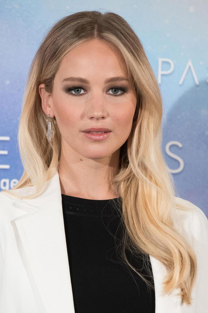 Jennifer attended the premiere of *Passengers* with sleek waves and a neutral smokey eye in 2016.