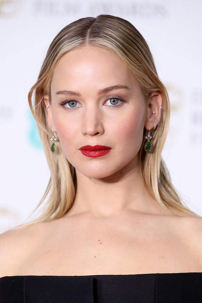 Proving that less is more, Jennifer wears a bright red lip and slicked hair at the BAFTAs in 2018.