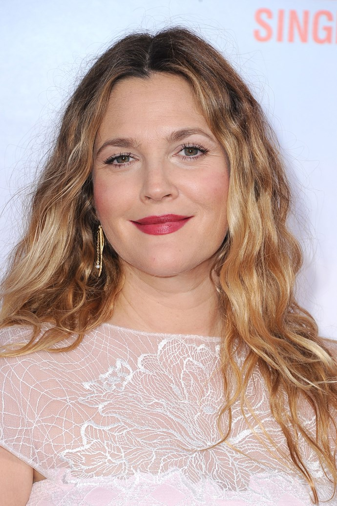 Barrymore wore a statement berry lip with natural waves at the premiere of *Blended* in 2014.