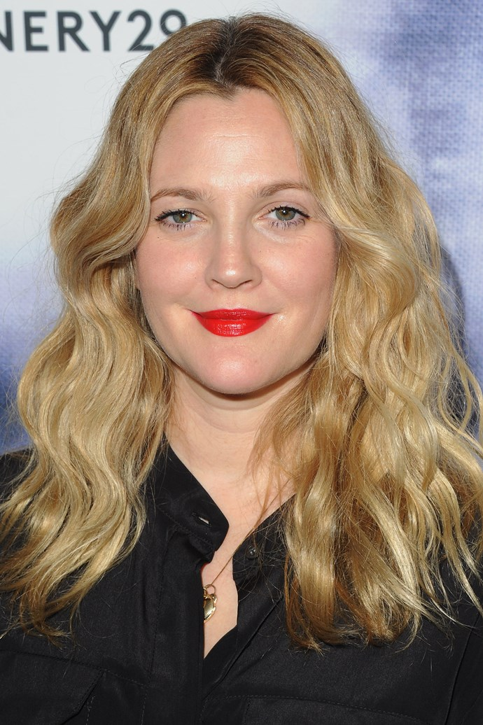 Proving her love for a statement lip, Barrymore wore a bright red lip paired with a glowing complexion at an event in 2014.