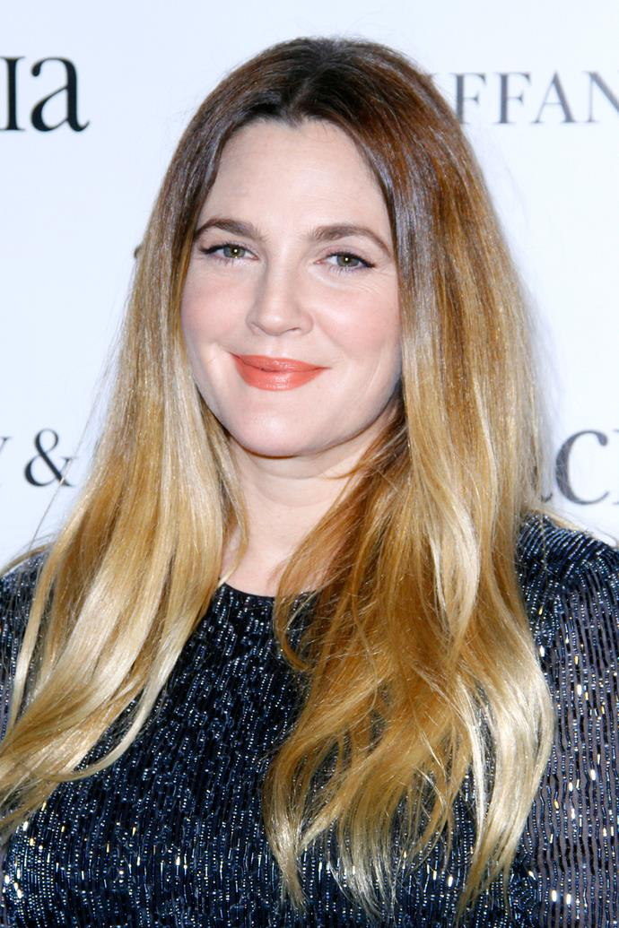 Barrymore opted for a winged eyeliner and coral lip, together with sleek waves at an even in 2015.