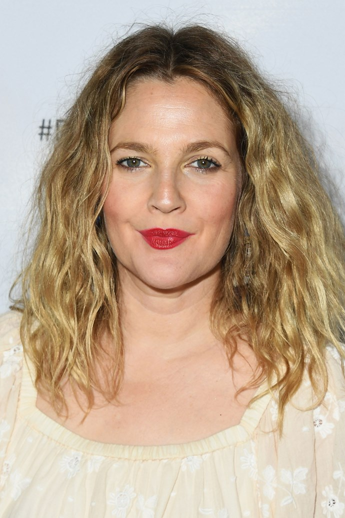 Attending the Beautycon Festival in 2018, Barrymore wore beachy waves and a bright red lip.