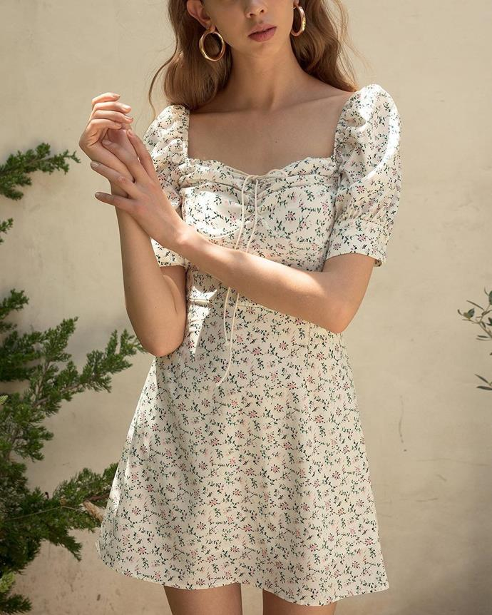"Dress, $145, at [Pixie Market](https://www.pixiemarket.com/collections/dresses/products/ria-floral-bustier-tie-dress|target=""_blank""