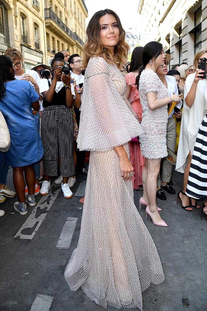 Wearing a semi-sheer gown by Ralph & Russo at Haute Couture Fashion Week in Paris.
