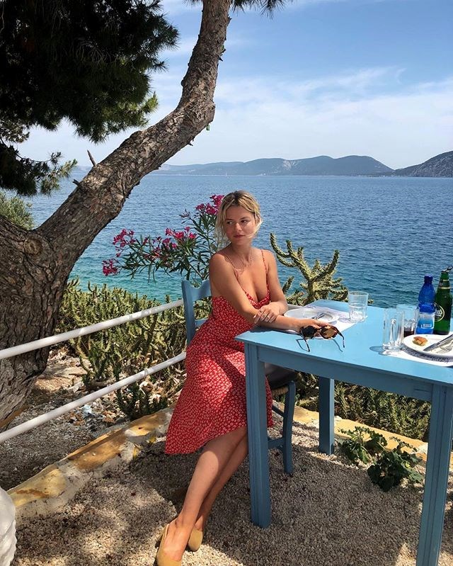 """***Long-live spaghetti straps, too*** <br><br> What's more of a French girl must-have than anything else? The cute-yet-comfortable spaghetti strap dress, that's as useful for dining out as it is for lounging around. Sabina Socol is pictured in the covetable ['GIGI' dress](https://www.rouje.com/e-shop/gigi-imprime-fleurette-rouge.html?___store=us_en&___from_store=fr