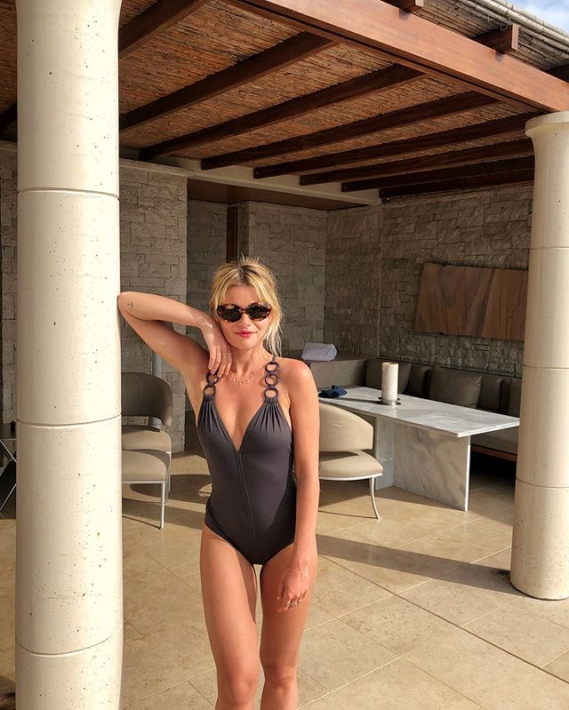 """***The '90s-style one-piece is back*** <br><br> One-piece swimwear has always reigned as a French girl staple, but Sabina Socol's choice of bangle-adorned swimwear (paired with Jane Birkin-esque sunglasses) makes for a wonderfully '90s poolside look—preferably at Hotel du Cap-Eden-Roc.  <br><br> *Image: [Instagram](https://www.instagram.com/p/BjCye8PlDdK/?taken-by=sabinasocol