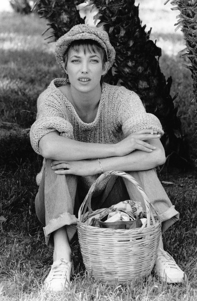 In an oversized jumper, white sneakers and a pageboy cap, with her signature basket.