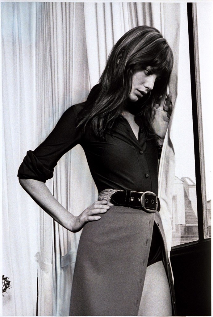Posing in a belted skirt and fitted shirt in 1971.