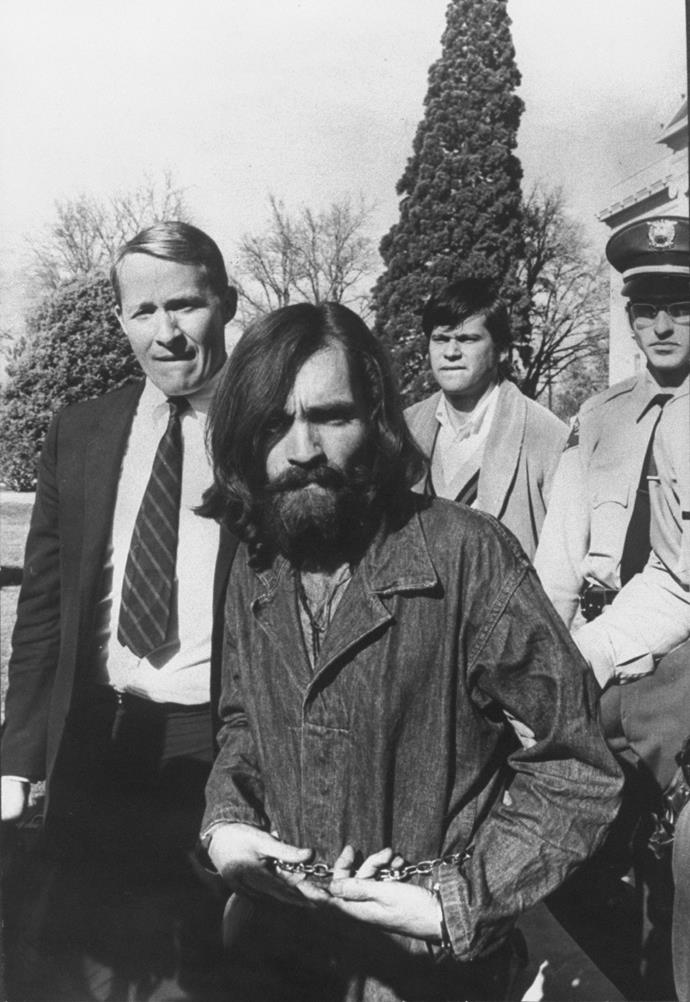 Charles Manson being lead out of court in 1969.