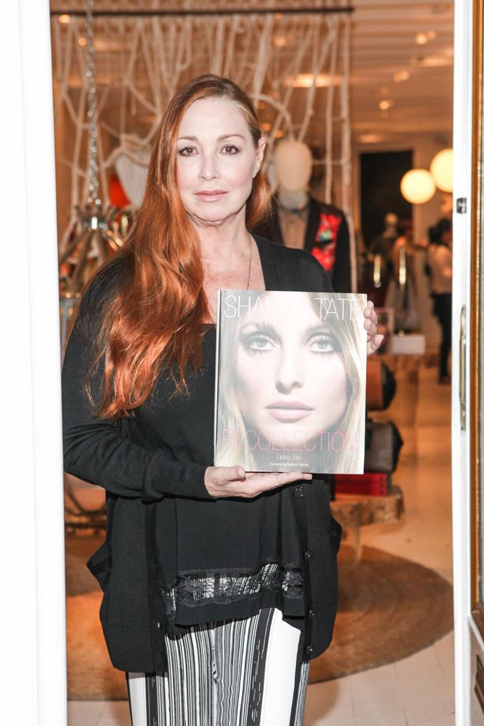 Tate's sister Debra with the book, *Sharon Tate: Recollection*.