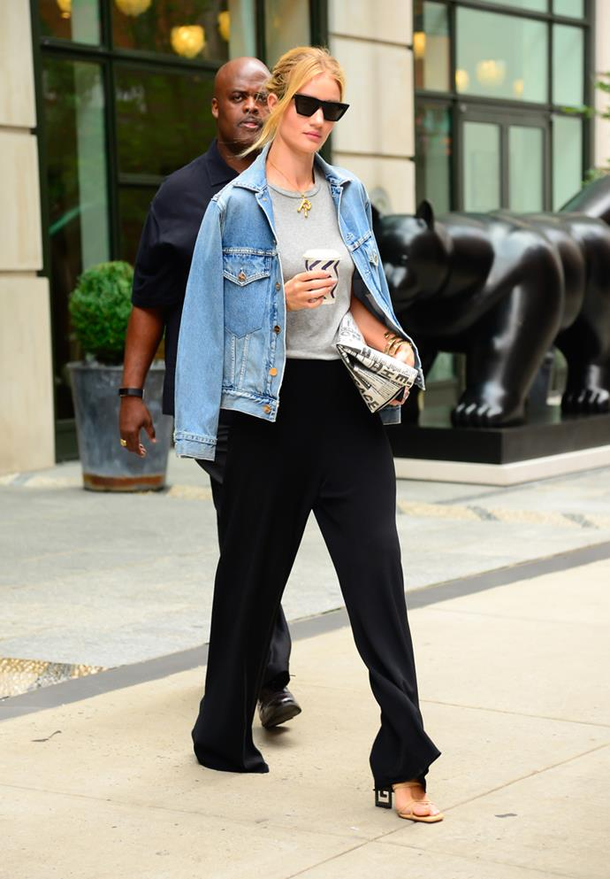 Wearing slouchy black trousers, heels and a denim jacket shrugged over the top in New York on August 14, 2018