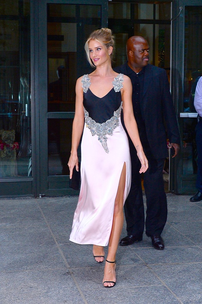 Wearing a black and blush Christopher Kane slip dress, finished with intricate stone embellishment in New York on August 14, 2018
