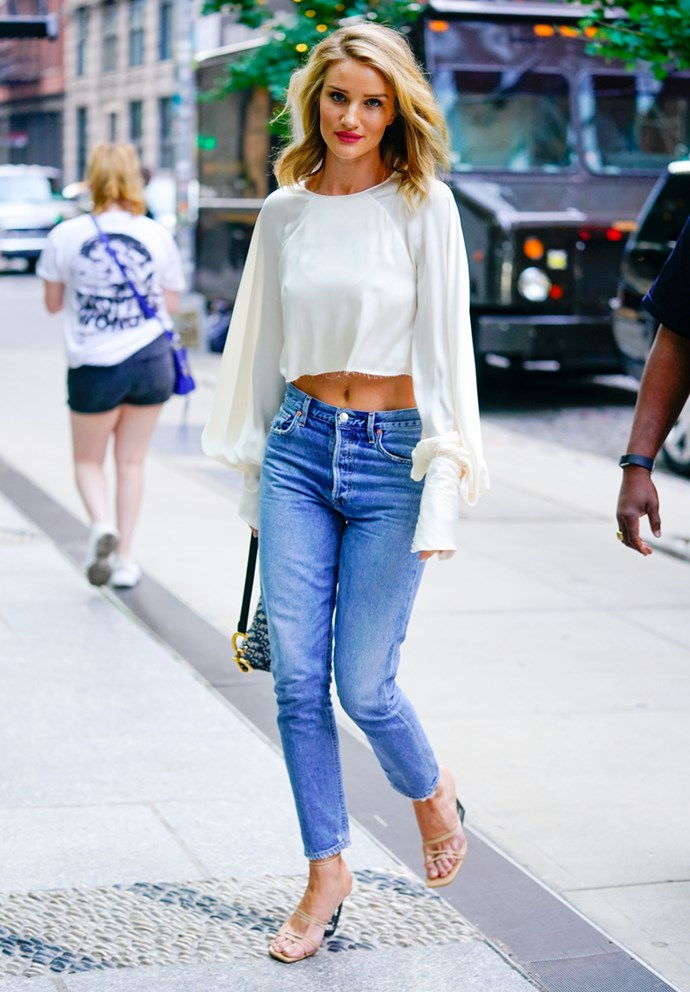 Wearing a cropped peasant-sleeve ivory blouse with a pair of mum jeans and matching heels in New York on August 15, 2018