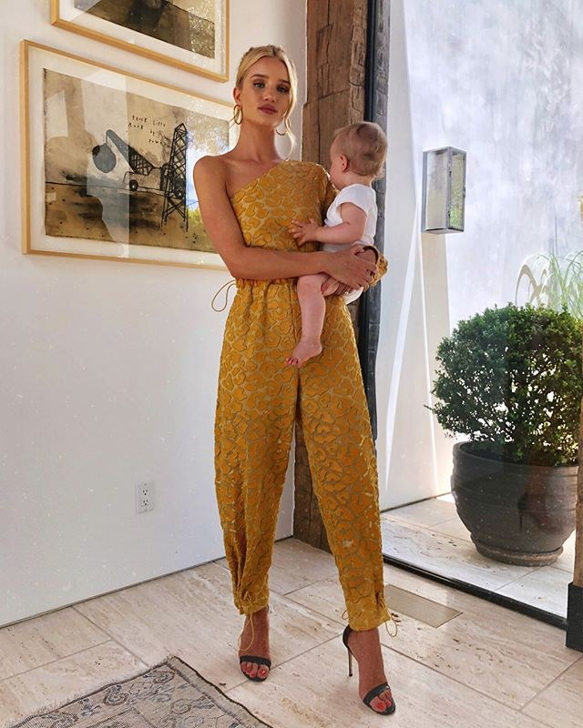 Wearing a one-shoulder marigold yellow Stella McCartney jumpsuit in Los Angeles on June 16, 2018