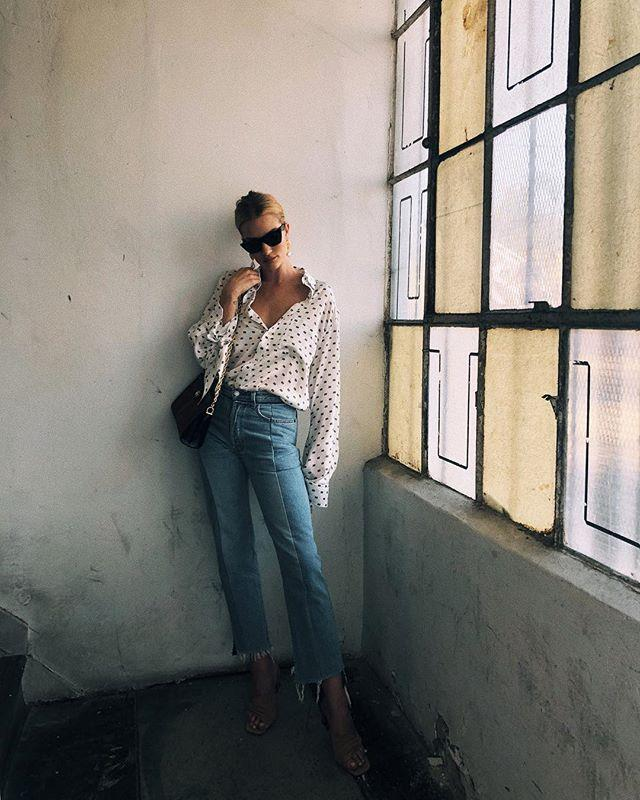 Wearing a printed Balenciaga shirt and frayed Vetements jeans on July 20, 2018