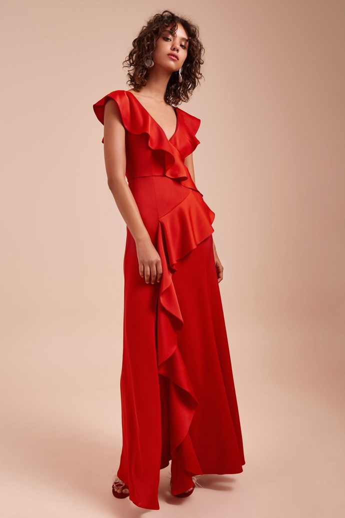 """Cat wore the 'Unwind' gown by [C/MEO COLLECTIVE](https://cmeocollective.com/products/unwind-gown-red