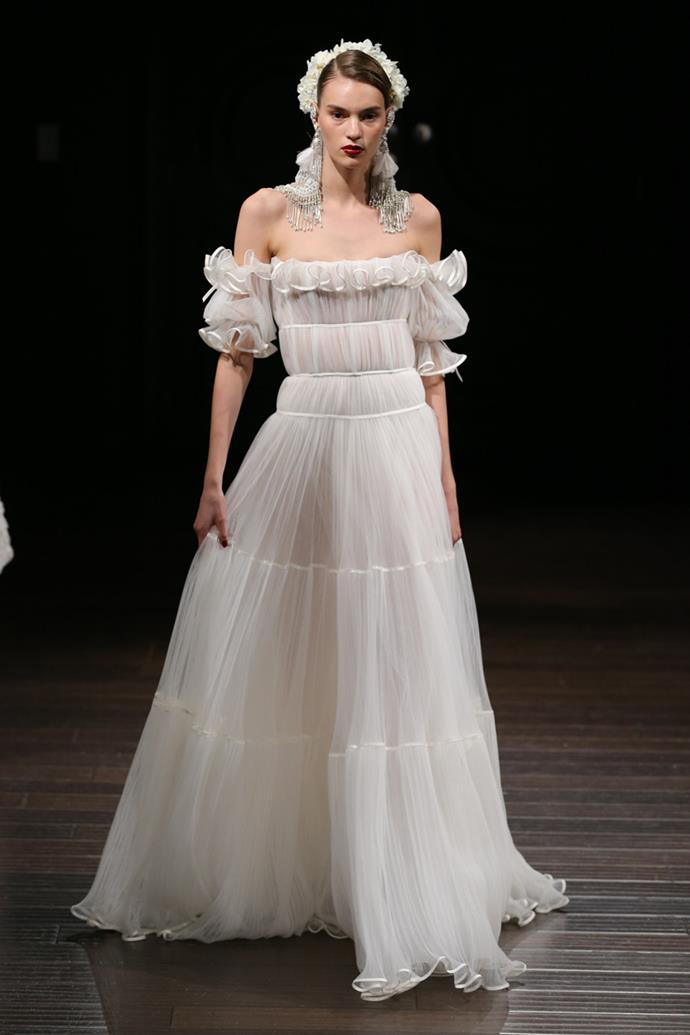 **Libra** <br><br> You like to do things a little differently, Libra. So why not take a slightly more eccentric approach to your wedding dress? Swap lace and florals for playful ruffles and chiffon. Extra points for statement accessories like oversized earrings or a eye-catching headpiece.