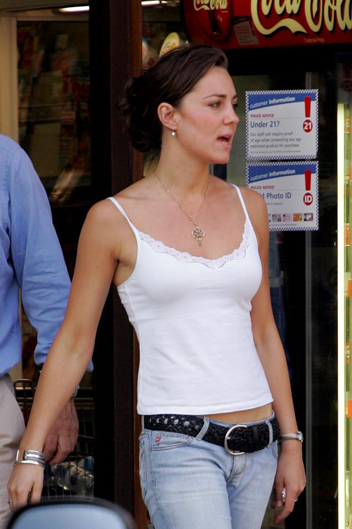 ***2005:*** Pictured in a now-iconic ensemble featuring low-rise jeans (a 2005 trend du jour) and spaghetti strap singlet.