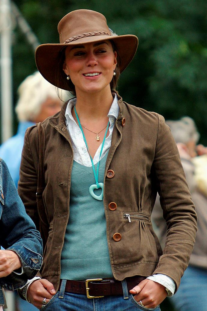***2005:*** In an outdoorsy ensemble at a festival at Gatcombe Park, England.