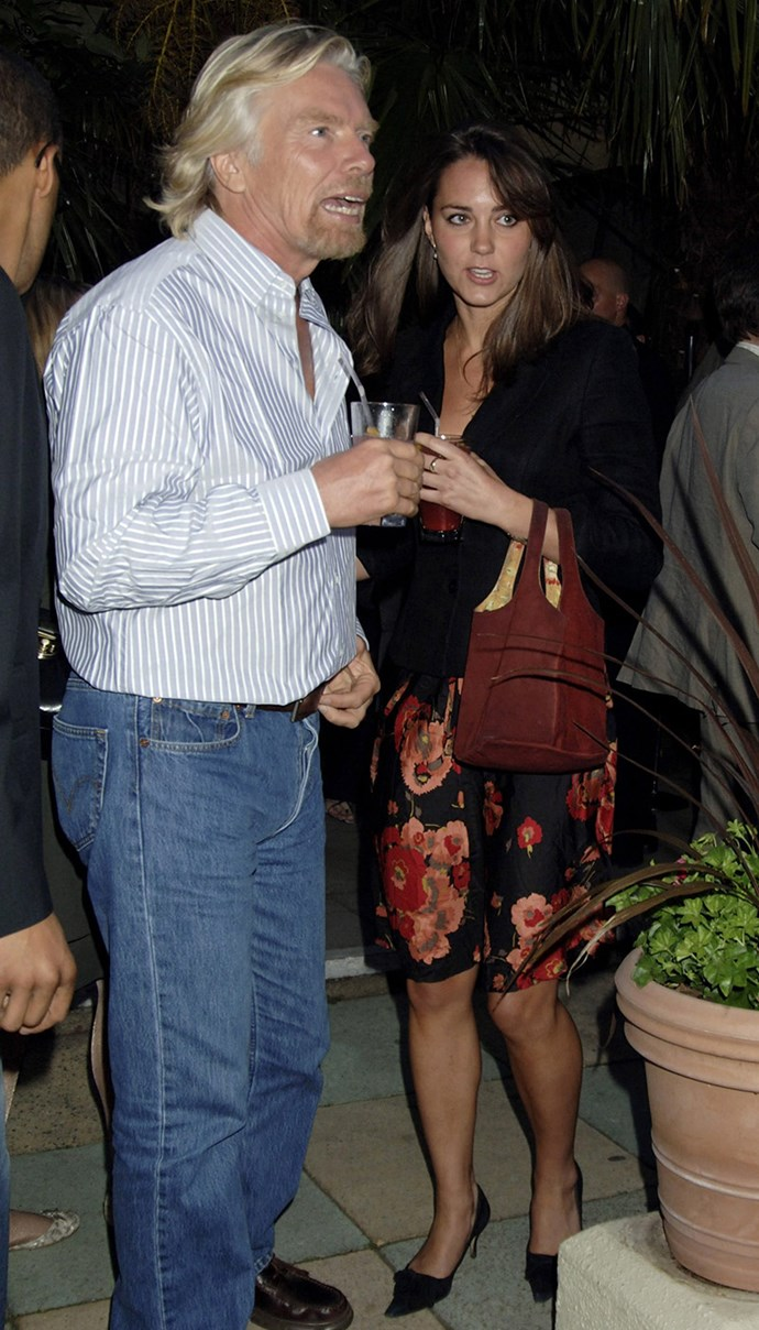 ***2006:*** Conversing with Sir Richard Branson at an event.