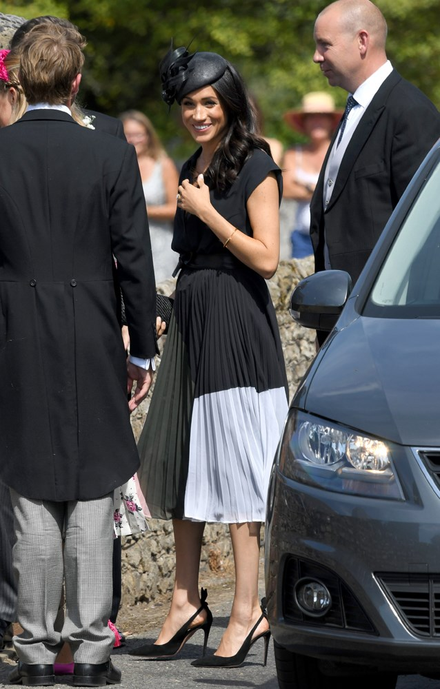 ***Charlie van Straubenzee's society wedding***<bR><br> Dress by Club Monaco: $446<br> Shoes by Aquazurra: $1,089<br> Clutch by Kayu: $306<br> Earrings Vanessa Tugendhaft: $1,849<br> Bracelet by Shaun Leane: $1,850<br> Belt by Miu Miu: $330<br> Sunglasses by Linda Foster: $1,402<br> Total: **$7,272**