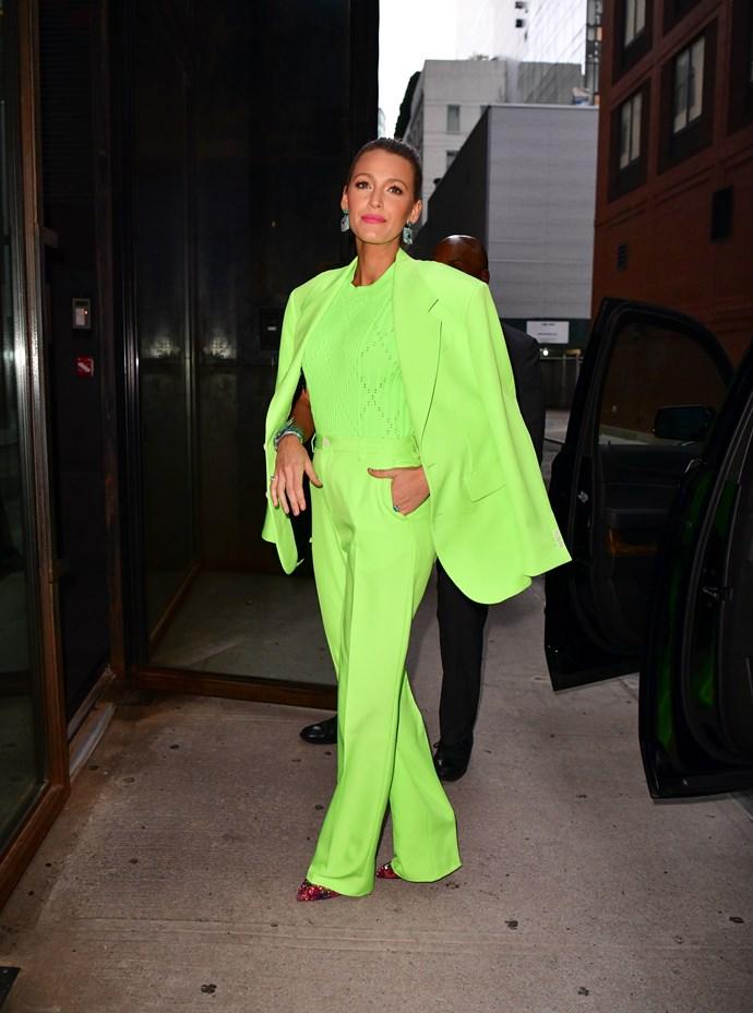 In a neon Versace menswear look.