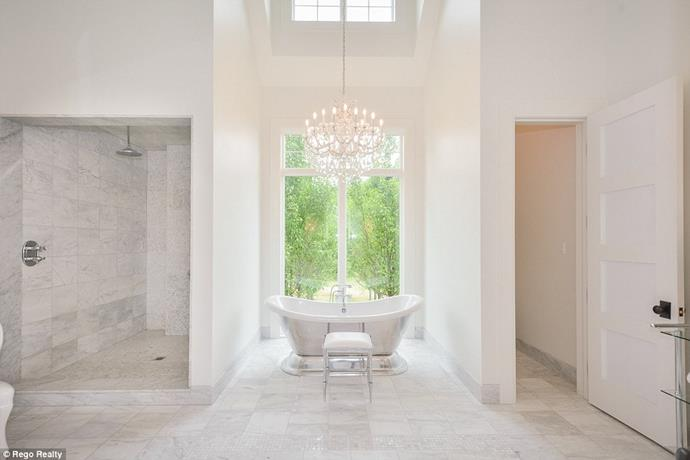 "A chandelier-lit bathtub.<br><br> Image via the *[Daily Mail](http://www.dailymail.co.uk/tvshowbiz/article-6091733/Justin-Bieber-snaps-5M-lakefront-mansion-Canada-complete-private-horse-track.html|target=""_blank""