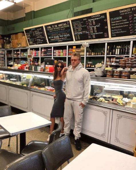 The couple stock up on deli goods in style.