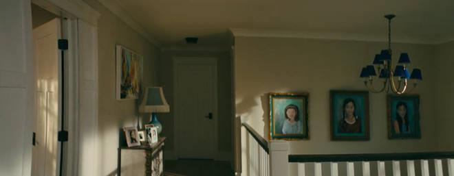 **There are three paintings hanging in the family landing area.** <br><br> The paintings, which appear to have been made by a family member (potentially their Mum?), are dedicated to each of the Covey kids: Lara Jean, Kitty and Margot
