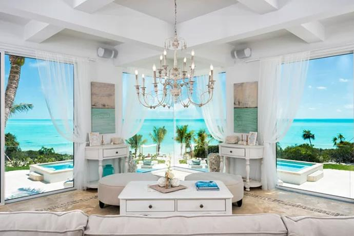 **Turks and Caicos: $50 Million Airbnb Mansion** <br><br> The Caribbean beachfront residence includes three separate private villas, totalling in 23 rooms. Each villa features includes its own pool, hot tub, private terrace and seaside cabana. The mansion also offers private tennis courts, a gym, spa, sauna, and an open-air massage table to its residents.