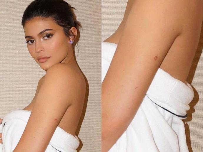 **KYLIE JENNER** <br><br> Kylie's first ever tattoo was a red ink heart on the back of her arm, debuting it at her 18th birthday party. In yet another instance of friendship tattoos, Kylie's former BFF, Jordyn Woods, and current BFF, Anastasia Karanikolaou (AKA 'Stass') each got the same outline of a heart.