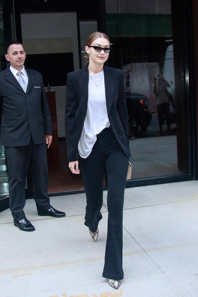 Gigi Hadid in a black suit and white shirt, September 5th, 2018.
