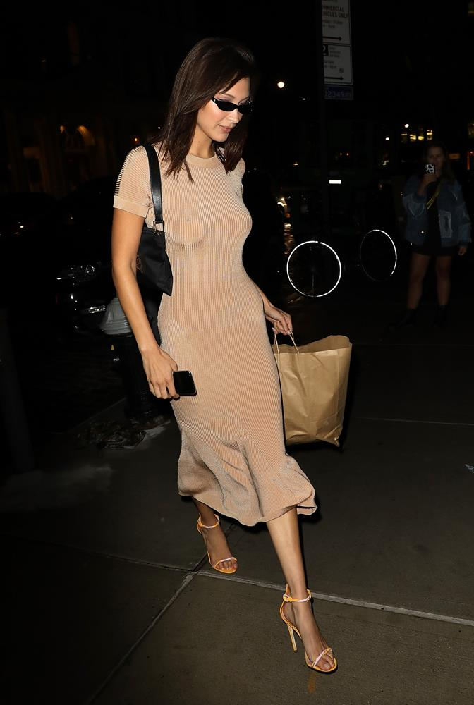 Bella Hadid in a nude dress and orange sandals, September 8th, 2018.