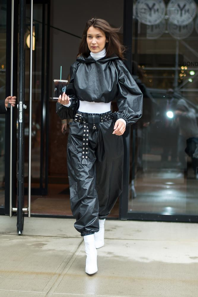 Bella Hadid in pleather co-ords with white boots, September 9th, 2018.
