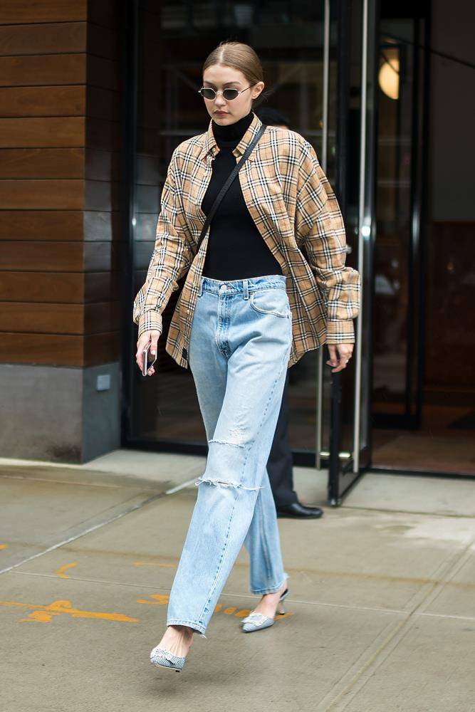 Gigi Hadid in a black turtleneck, wide-leg jeans and a Burberry shirt, September 9th, 2018.