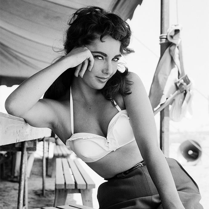 """***Elizabeth Taylor*** <br><br> Rebecca Harrington, author of """"*I'll Have What She's Having: My Adventures In Celebrity Dieting*"""", tested Elizabeth Taylor's diet—which consisted of scrambled eggs, bacon and a mimosa for breakfast (*goals*), French bread with peanut butter for lunch, and fried chicken, peas, gravy, mashed potato, corn bread and a glass of Jack Daniels for dinner.  <br><br> The result? After 14 days, Harrington lost just under 3kg."""