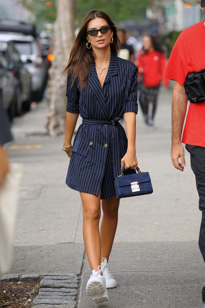 Wearing a pinstripe navy LPA blazer dress and AMI sneakers in New York City, September 2018.