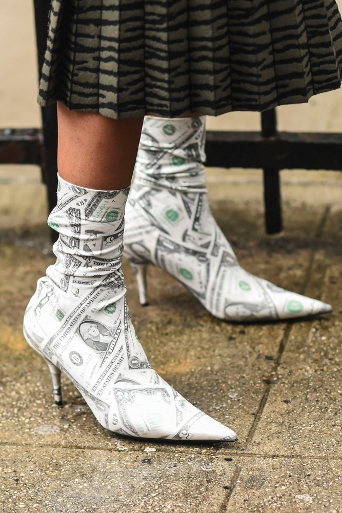 ***Printed boots***<br><br> Plain boots are out. From money to newspaper to flyers, the printed boot has returned to give your feet something to say.