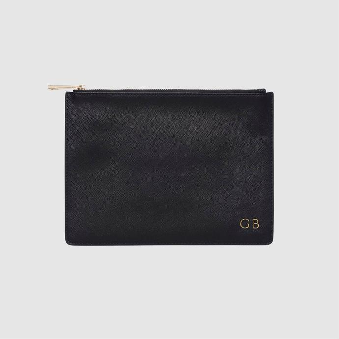 "<strong>A personalised clutch</strong><br><br>  Whether it's in versatile black, or a hue that matches your wedding aesthetic so that your bridesmaids can carry them on the day. this sweet clutch is perfect. <br><br> Clutch, $89.95, [The Daily Edited](https://www.thedailyedited.com/black-pouch-gold-hardware|target=""_blank""