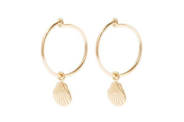"Earrings, $240 at [Sarah & Sebastian](https://www.sarahandsebastian.com/products/shell-hoops-yellow-gold|target=""_blank""