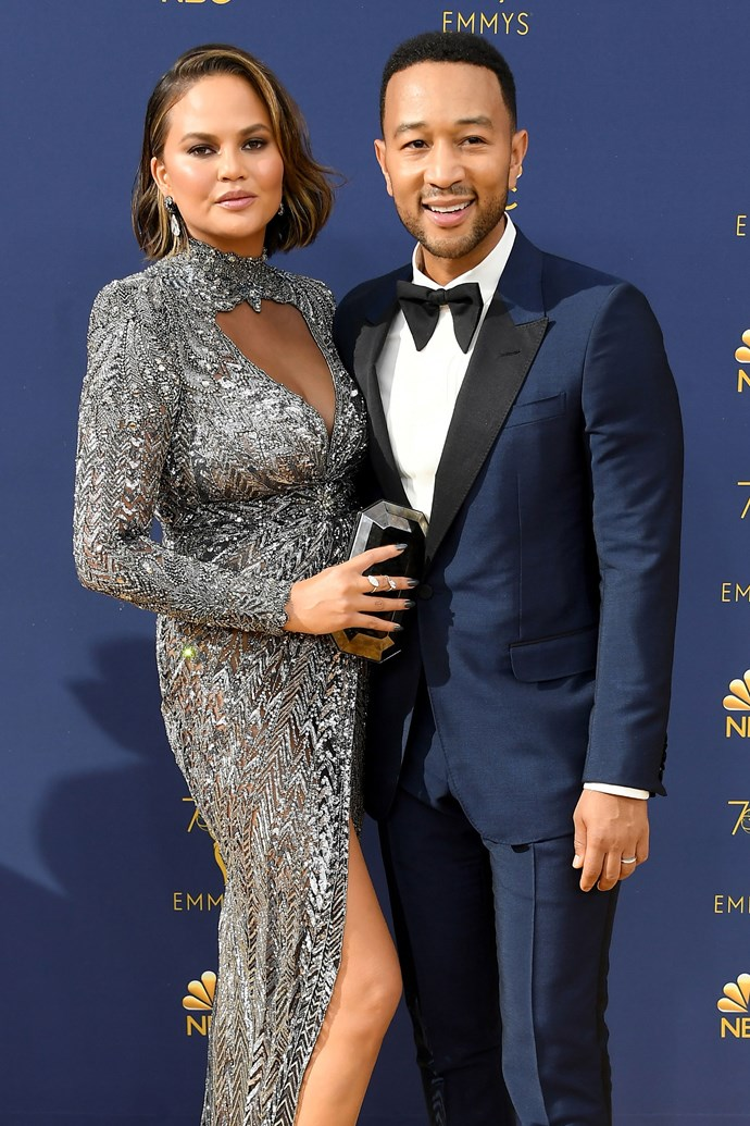 Chrissy Teigen and John Legend. <br><br> Teigen stepped out in support of her husband, who not only performed the opening number for the show, but who has also become the first black male to reach EGOT status after winning an Emmy for *Jesus Christ Superstar Live* at the Creative Arts Emmy Awards earlier this week.