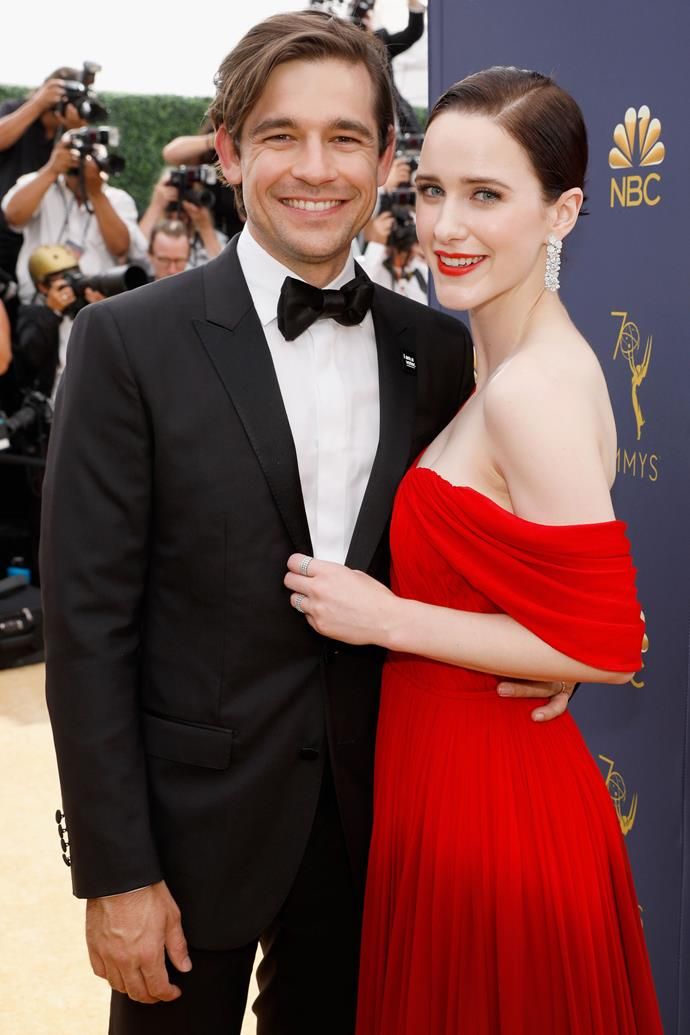 Rachel Brosnahan and Jason Ralph. <br><br> Although blissfully unaware that she would soon win an Emmy for her role in *The Marvelous Mrs. Maisel*, the actress beamed as she walked the red carpet with her long-time love, fellow actor Jason Ralph, who both couldn't wipe the smiles off their faces or keep their hands off one another.