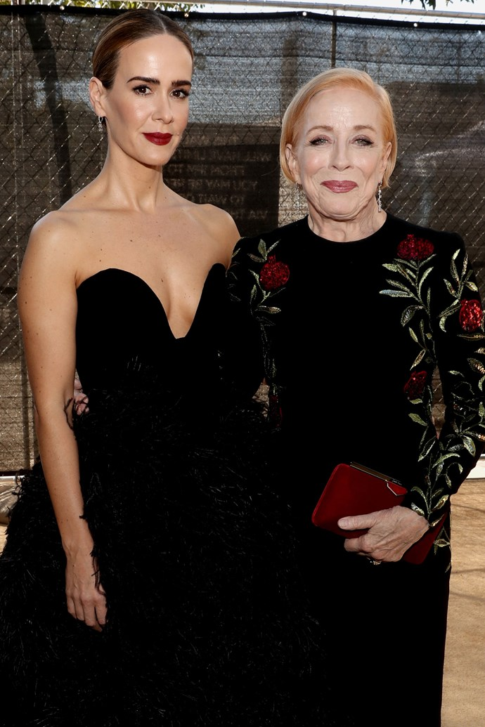 Sarah Paulson and Holland Taylor. <br><br> Now red carpet regulars, Paulson and Taylor not only coordinated their red carpet outfits to perfection, but shared a sweet embrace as they posed for photographers. Taylor was also in attendance to support her girlfriend's 'Lead Actor In A Limited Series Or Movie' nomination.