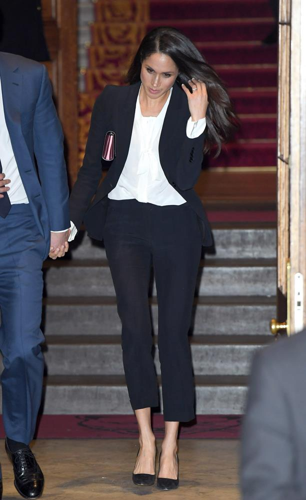 "***Her love of suits***<br><br> Both before and after her royal life, Meghan has made it very clear she's a fan of wearing suits. But it's no surprise that hardcore royal fans don't feel the same. ""I am disappointed. She looks good in dresses. Why not wear one?"" wrote one. ""Can't she please wear a dress to one of these engagements?!"" said another."