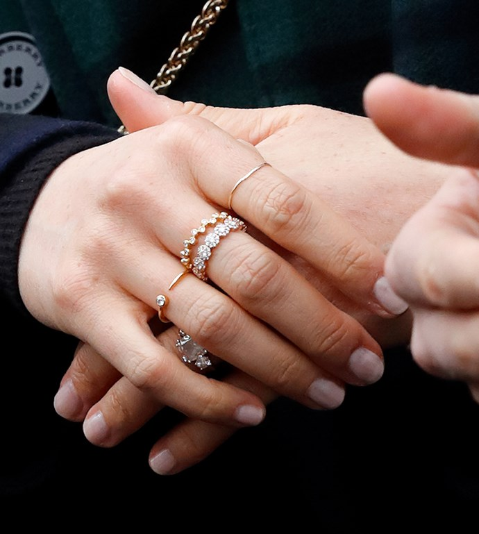 ***Her fondness for layering jewellery***<bR><br> Prior to her wedding, Meghan was a big fan of layering her jewellery—from stacking rings to wearing multiple earrings at once. Considering this is hardly the royal way of things, not everyone was happy about her OTT accessorising.