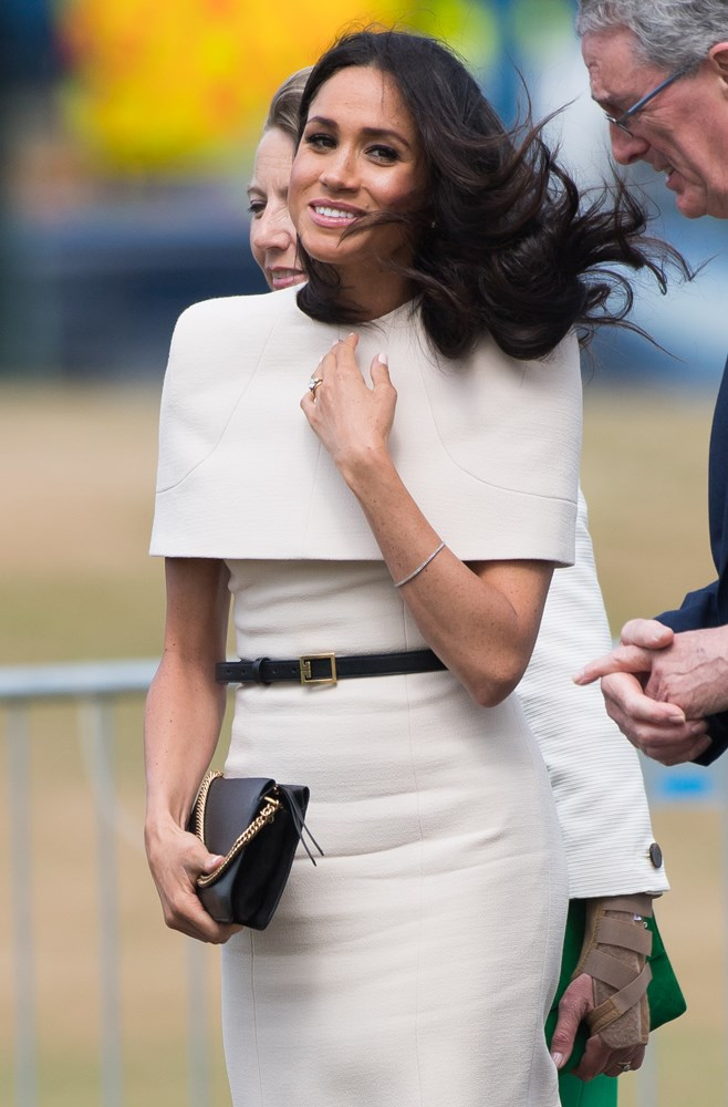 ***Her caped dress***<br><br> Although most agreed that Meghan's caped Givenchy dress for her first engagement with the Queen was a hit, several fans pointed out that she ought not to have left her hair out, seeing as she couldn't reach her arms up to smooth it out in the wind.