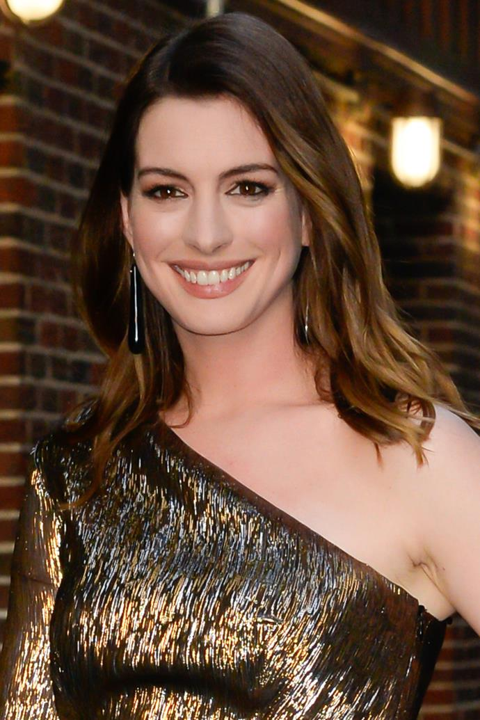 One of Hollywood's most famous brunettes, Anne Hathaway, debuted her blonde 'do at New York Fashion Week in 2018.